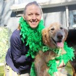 woman and her dog celebrating St. Patrick's Day